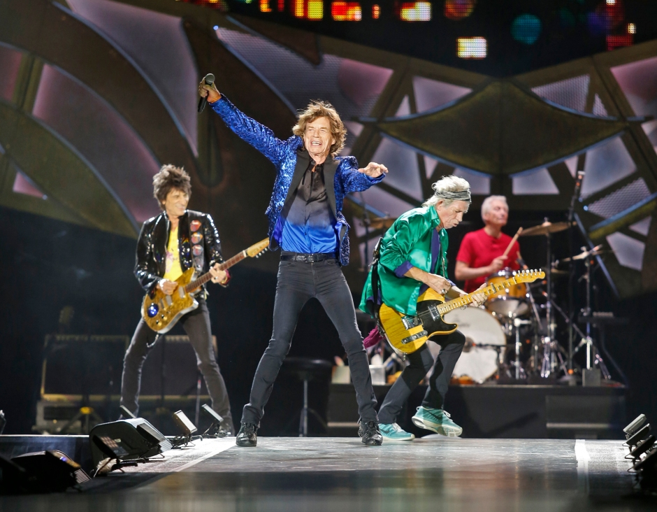 Mick Jagger leads off with Jumping Jack Flash during Saturday night's show at the OSU stadium. (Tim Johnson/Alive)